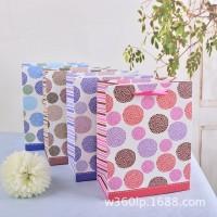 供应高档白卡纸印刷手提包装纸袋 创意圈圈服装包装礼品袋子批发